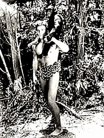 Actor Buster Crabbe as Tarzan with friend