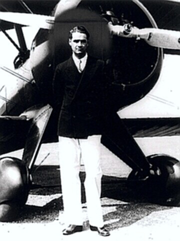Aviator Howard Hughes by his plane