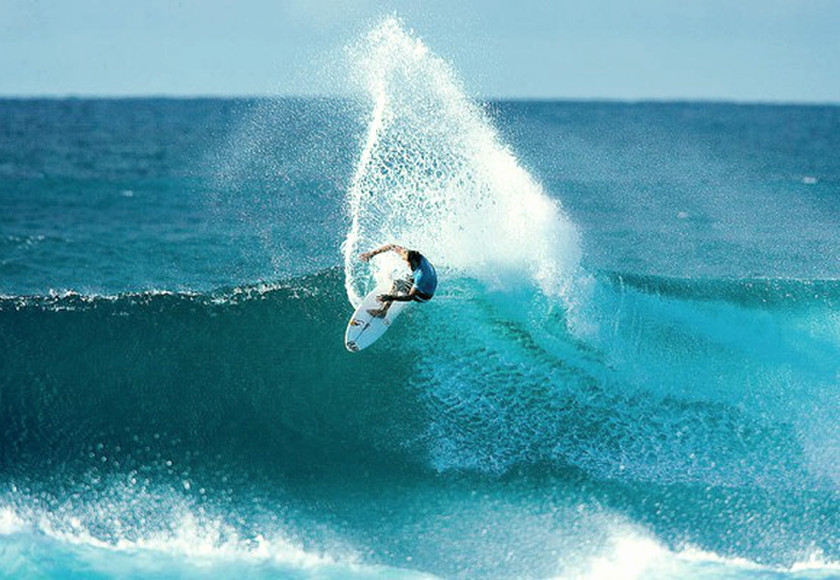 Champion Surfer Andy Irons at work