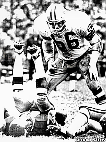 Ray Nitschke stands over decleated ball carrier