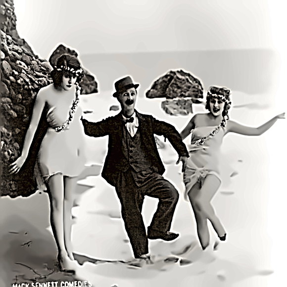 Actor Ben Turpin w/ beach-gals