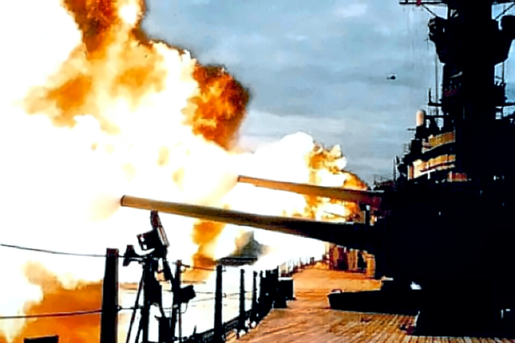 USS Missouri firing a broadside